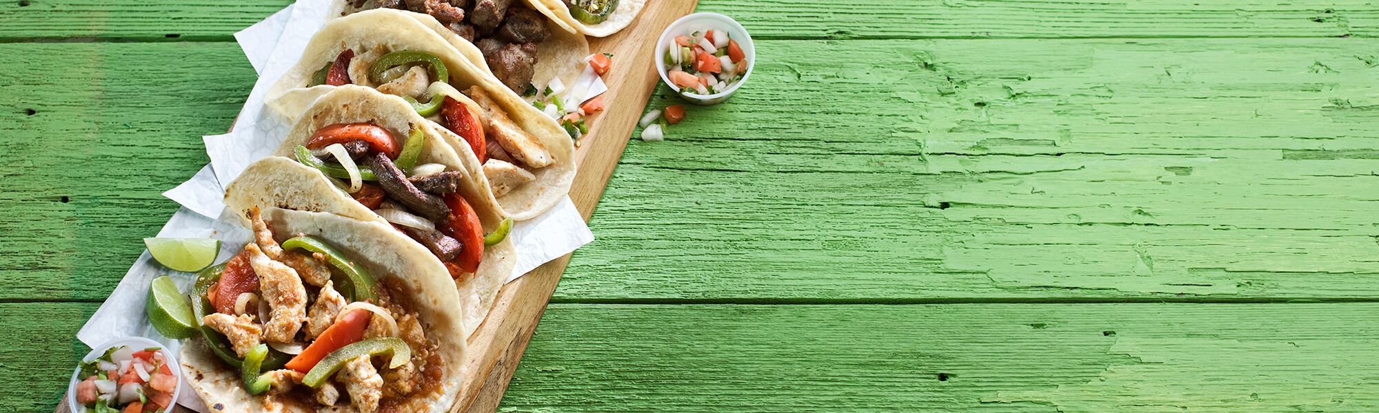 Lunch and Dinner Tacos on Wooden Board